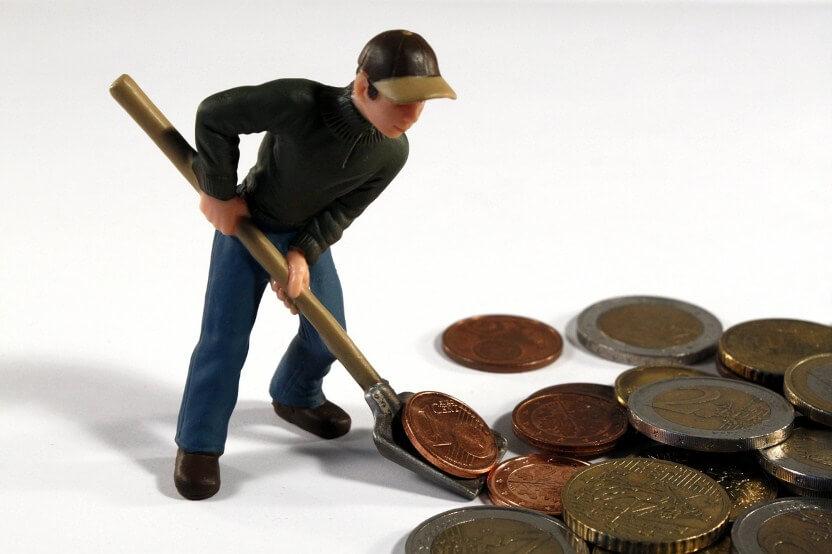 man shovel money